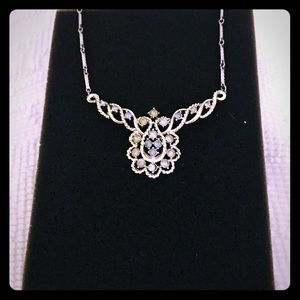 Jewelry - Silver Necklace with Blue Rhinestones.